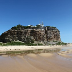 A photo of Nobby's head and icon of Newcastle NSW